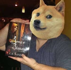 Craig with book and dog head